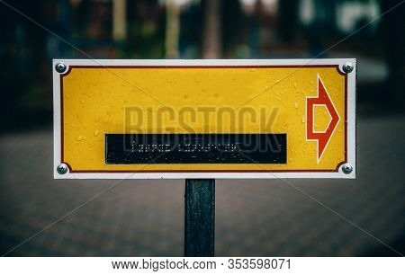Yellow Plate For Your Text With Dots For Reading By Hands For The Blind. Signpost Sign For The Blind