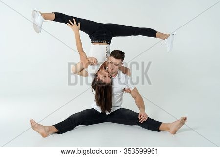 Duo Of Acrobats Showing Tricks, Isolated On White