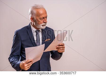 Portrait Of Serious And Pensive Senior Businessman.