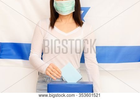 Israeli Woman With Face Medical Protected Mask Putting Ballot In A Ballot Box On Election Day On Isr