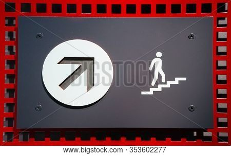 Concept Of Sign With Arrow Pointing Up And Figure Of Person Going Upstairs