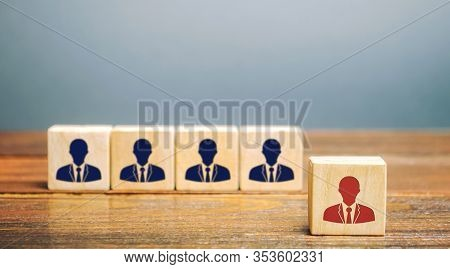 Wooden Blocks With The Image Of Workers. Leadership Concept. Stand Out From The Crowd. The Best Empl
