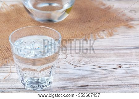 Glasses Of Water On A Wooden Table.