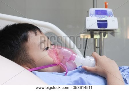 Boy Patient With Asthma Allergy Using The Asthma Inhaler.inhaler Mask For Treatment In Hospital.heal