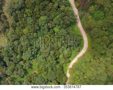 Aerial View Of Winding Road With Pine Tree Forest In Mountain.scenery Bird Eye View Of Asphalt Road