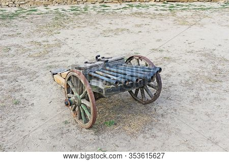 Cannon At Battle Fieldan Old Cannon On Wheels. Military Weapon