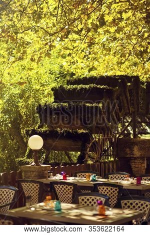 Vertical View Of Water Wheels In Sunny Day On River Sorgue In Fontaine De Vaucluse, Vaucluse, Proven
