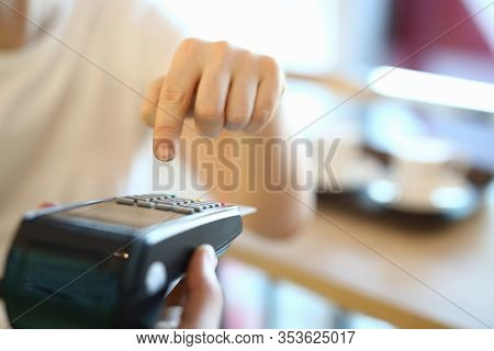 Man Dials A Pin Code At Terminal, Payment By Card. Selection An Effective Acquiring Offer. Payment B
