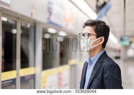 Young Asian Man Wearing Protection Mask Against Novel Coronavirus Or Corona Virus Disease (covid-19)