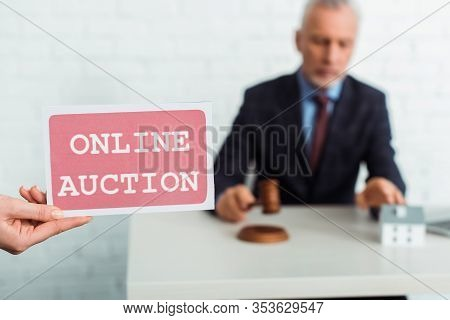 Cropped View Of Woman Holding Card With Online Auction Lettering And Auctioneer Holding Gavel