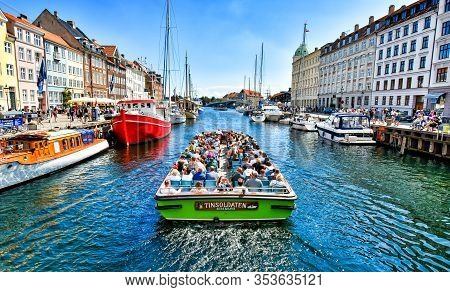 Copenhagen, Denmark - July 15, 2017: A Tourist Excursion Boat Travels On The Canal In The Nyhavn In