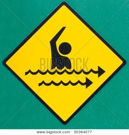Rip current hazard symbol warning sign on green