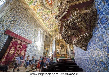 Coimbra, Portugal - Sept 6th 2019: Visitors At University Chapel Or Capela De Sao Miguel Chapel. Tou