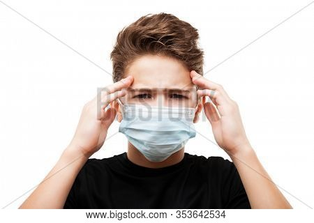 Human population virus, infection, flu disease prevention and industrial exhaust emissions protection concept - teenager boy wearing respiratory protective medical mask suffers headache white isolated