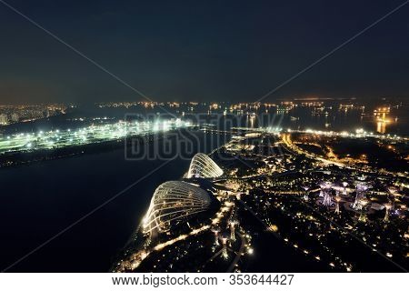Singapore rooftop view with urban skyscrapers at night.