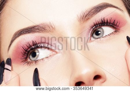 Portrait Of A Girl With Long Nails, Close-up Of A Girl With Pink Shadows, Professional Eyebrows. Bea