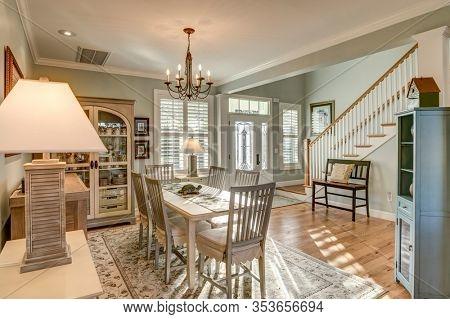 Beautiful open diningroom with light coming through door and windows.