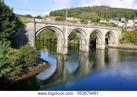 Portochao Bridge, Bridge Of The Railroad Track, On The Landro River In The City Of Viveiro, Lugo, Ga