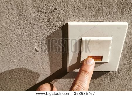 A Finger Pressing Door Bell Or Activating A Switch Giving Alert.