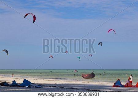14.02.2019  Coast Of Zanzibar Island Near Jambiani Village, Tanzania. Tourists From All Over The Wor