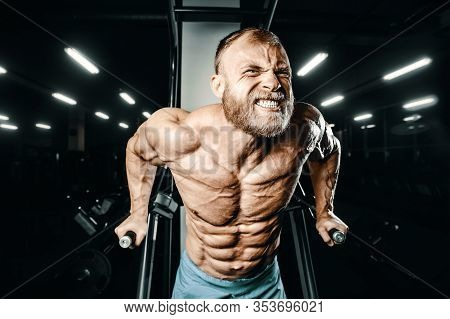 Bodybuilder Pumping Up Chest Muscles Push-ups Bars