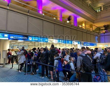 Orlando,fl/usa-2/27/20:  People Waiting In Line To Go Through Orlando International Airport Mco Tsa