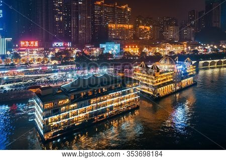 CHONGQING, CHINA – MARCH 13: Nanbing Road with boat restaurant at night on March 13, 2018 in Chongqing. With 17M population, it is the most populous Chinese municipality.