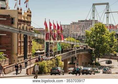 Sydney, Australia - December 11, 2009: Traffic By Car And Pedestrians On Overpasses And Bridges At D
