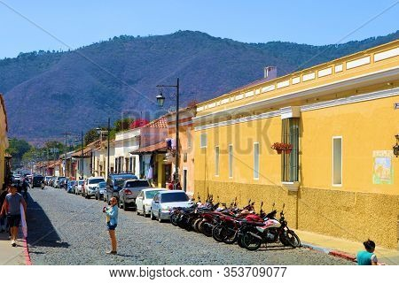 February 25, 2020 In Antigua, Guatemala:  Colorful Historical Spanish Colonial Style Buildings Besid