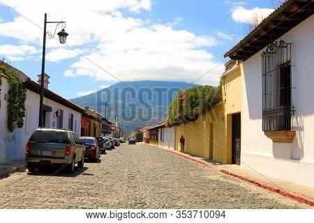 February 25, 2020 In Antigua, Guatemala:  Original Cobblestone Street Surrounding Historical Spanish