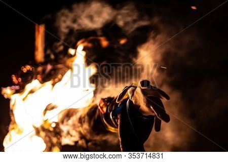 Burning ritual doll in flames on traditional holiday Maslenitsa