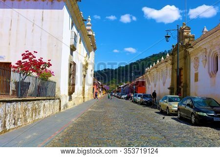 February 25, 2020 In Antiqua, Guatemala:  Historical Cobblestone Street Surrounded By Vintage Spanis
