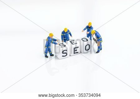 Seo, Search Engine Optimization, Building The Website With Keywords Concept, Miniature People Techno