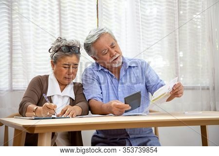 Asian Senior Couple Serious Worried With Calculating Bills To Pay Per Month Or Debt, Retired Elderly