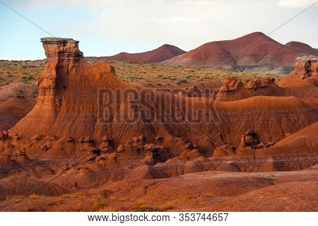 Scenic Utah state park Goblin Valley. USA. Hoodoo - high thin geological formations. Many funny  figures of red-brown sandstone. The concept of active, informative, ecological and photo tourism