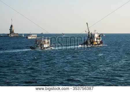 Istanbul, Turkey - September 05, 2019: A Marine Towing Ship Drags A Broken Yacht Into Port Along The