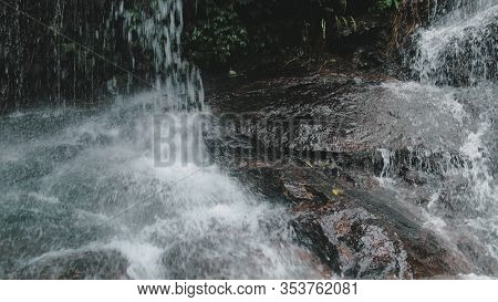 Mountain Cascade Wild Waterfall Thailand Vacation. Babbling on Rocks in Rainforest. Fresh Clear Water Flowing in Jungle. Green Fern Foliage on Stones Close up. Exotic Forest.