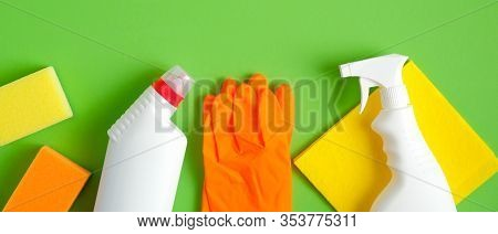 Cleaning Service Banner Mockup. Flat Lay House Cleaning Supplies On Green Background. Top View Clean