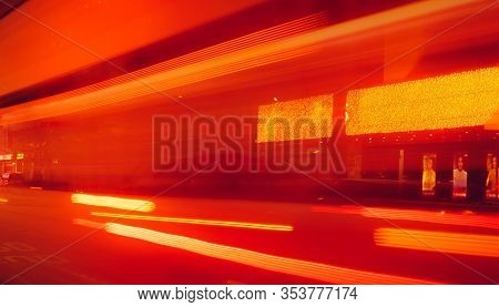 City Street In The Night With Blurred Fast Speed Car Light. Red And Yellow Light At The Rod Beside T