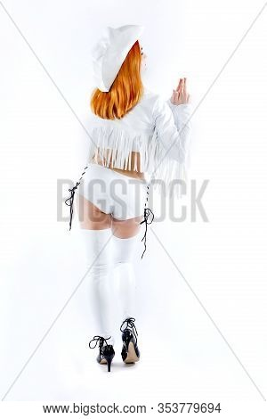 Cowboy Girl Or Pretty Woman With Blond, Red Hair In Stylish Hat Showing Finger Gun, Hand Gesture, On