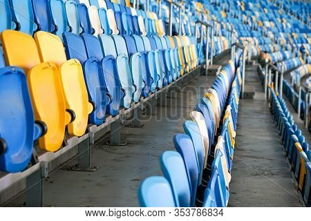 Close Up Of The Stadium Seat Colorful. Plastic Seat Rows At The Arena. Pattern Texture Of Set Chairs