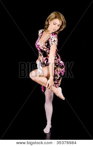 Sweet-faced Fashion Model In Colorful Spring Outfit Removing Her Stocking.