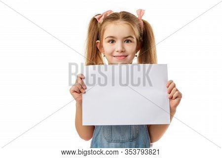 Happy Cute Child Holding Empty Blank Isolated On White Background. Kid With Placard Board For Your T