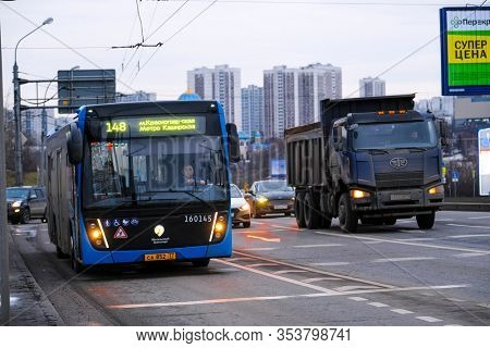 Moscow, Russia - February, 18, 2020: image of a bus near a bus stop in Moscow