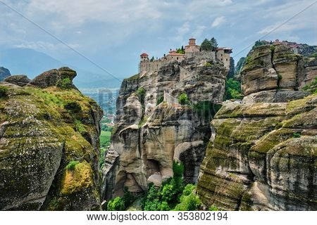 Monastery of Varlaam and Monastery of Great Meteoron in famous greek tourist destination Meteora in Greece on sunset with scenic scenery landscape