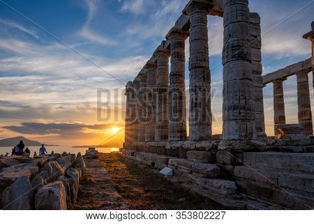 Cape Sounio sunset at Sounion with ruins of the iconic Poseidon temple. One of the Twelve Olympian Gods of ancient Greek religion and mythology. God of the sea, earthquakes. Aegean coast, Greece.