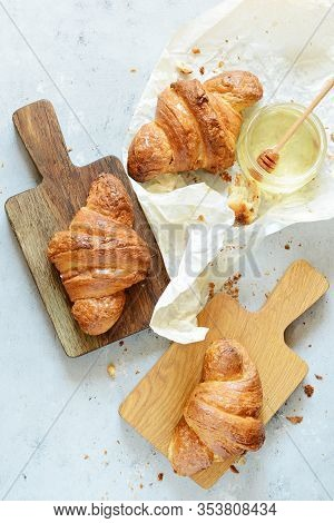 Fresh French Croissant With Honey For Breakfast. Homemade French Croissants On A Background. Ruddy C
