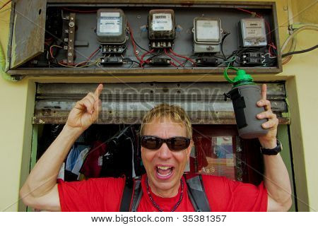 Man Pointing At Obsolete Electrical Wiring