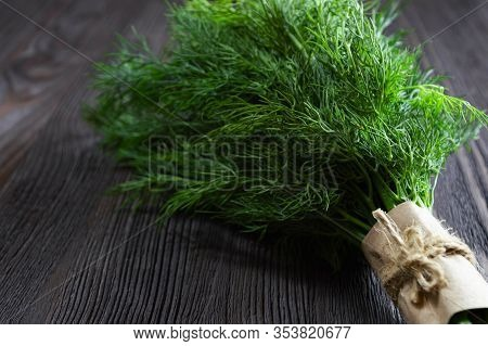 Bunch Of Fresh Dill And Spices On Dark Wooden Background.