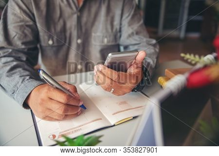 Male'hand Of Planner Writing Daily Appointment On 2020 Calendar Book.asian Man Plan And Noted Schedu